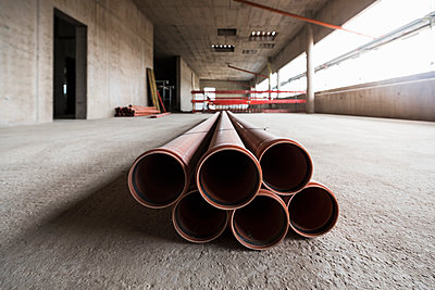 Pipes in an unfinished building under construction - p300m1449576 by Daniel Ingold