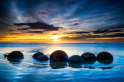 Moeraki Boulders at Sunrise, Otago Coast, New Zealand - p651m2006547 by Tom Mackie