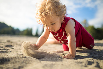Toddler plays in the sand. - p1166m2202153 by Christopher Kimmel / Alpine Edge Photography