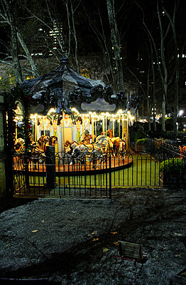 Small Carousel at night - p1072m829442 by Neville Mountford-Hoare