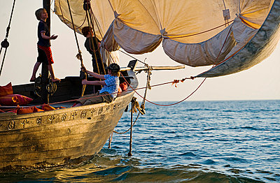 Boys on a family holiday, cruise round Lake Malawi in a traditional dhow - p6521858 by John Warburton-Lee