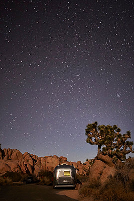 Travel trailer at Joshua Tree National Park, California - p924m1125688f by Seth K. Hughes