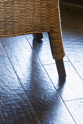 Wicker Chair on Hardwood Floor - p5550741f by LOOK Photography
