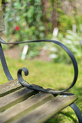 Closeup of a traditional, rustic wooden bench. - p1433m2026066 by Wolf Kettler