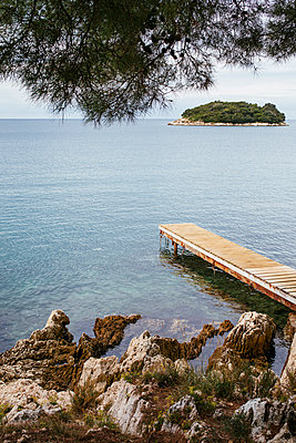 Wooden pier in the bay of Vrsar - p728m2027244 by Peter Nitsch