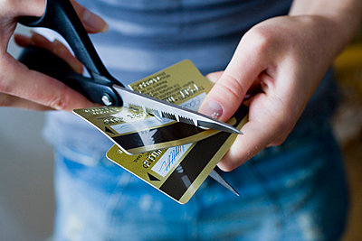 Two cut credit cards - p4263227f by Tuomas Marttila