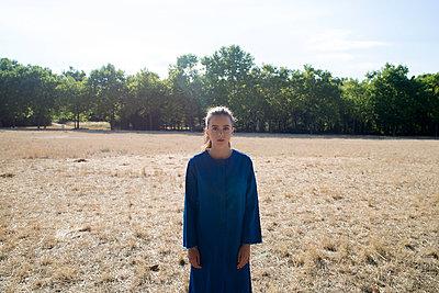 Girl in blue coat in the field - p1096m1051340 by Rajkumar Singh