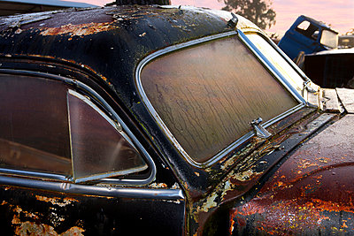 Close up of vintage car in scrap yard - p429m875755f by Zero Creatives