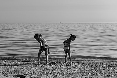 Girls Looking on the beach - p448m939656 by Safia Fatimi