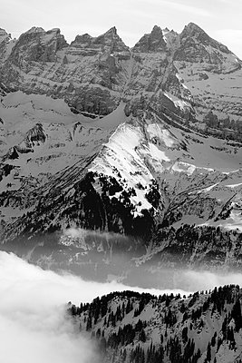 High angle view of steepy alps in fog at France remote ridge scenery silence slope snow snowy steep - p1025m788641f by Nicklas Blom