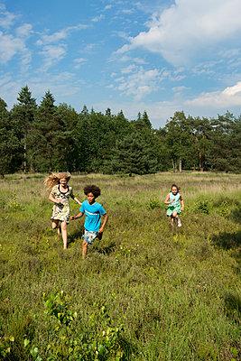 Kids play in the woods - p1132m1152775 by Mischa Keijser