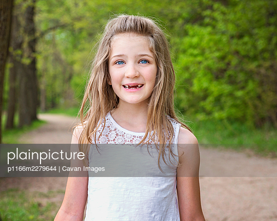 Young Blond Girl Hiking in the Woods - p1166m2279644 by Cavan Images