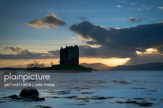 Sunset over Loch Linnhe and Castle Stalker, Highland, Appin, Scotland, United Kingdom - p871m2113674 by John Potter
