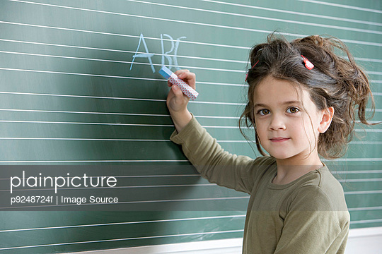 Girl with chalk - p9248724f by Image Source