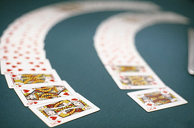 Playing cards spread out on a table, Las Vegas, Nevada, USA - p3011633f by fStop