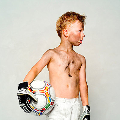 Little boy with football - p5760002 by Stefanie Link