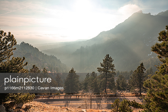Misty morning in the Rocky Mountains - p1166m2112830 by Cavan Images