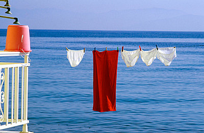 Greece, Corfu - Towel and underwear drying on a clothesline - p3483887 by Helena Nara