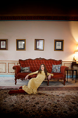 Woman in a castle in front of a sofa - p1105m2245464 by Virginie Plauchut