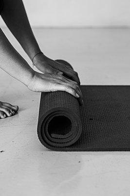 Unrolling a yoga mat - p1640m2254663 by Holly & John