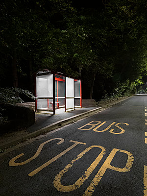 Illuminated bus stop at night, huge letters - p1280m2220212 by Dave Wall
