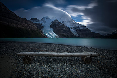 Bench on a glacial lake, Mount Robson Provincial Park, British Columbia, Canada - p343m1184593 by Paul Zizka