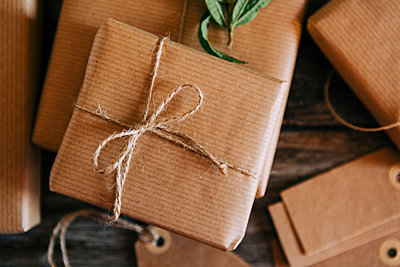 Presents wrapped in brown paper and string - p1427m2136018 by Alexandra C. Ribeiro