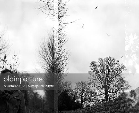 Woman watching flying birds