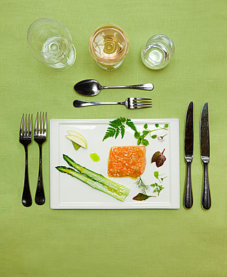 Place setting with food on plate - p312m1121639f by Susanne Walstrom