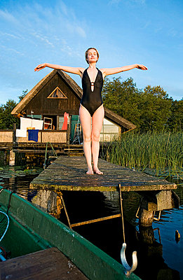 Woman posing in swimsuit - p4240265 by Justin Winz