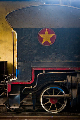 Steam engine in process of being restored at a workshop in the Railway Worker's Khu Tap The, Hanoi, Vietnam, Asia - p934m832495 by Dominic Blewett