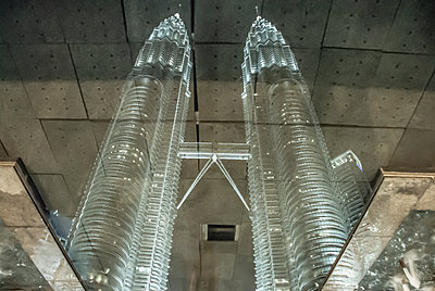 Petronas Tower`s reflection in fountain water - p1166m2137888 by Cavan Images