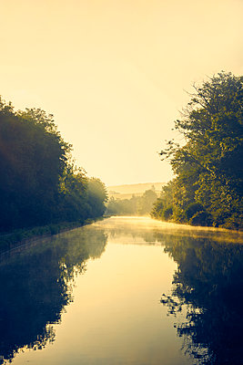 River in the morning in backlight - p1312m2258011 by Axel Killian