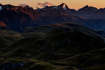Plateau d'Emparis sunset glow in the Alps - p910m1159408 by Philippe Lesprit