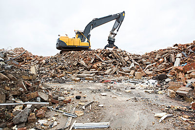 Digger and building rubble - p1057m1045138 by Stephen Shepherd