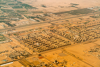 Aerial view of new residence suburbs in Cairo in the desert - p1332m1491348 by Tamboly
