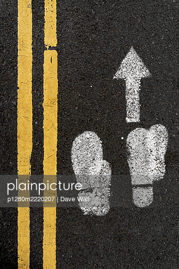 Social Distancing sign and double yellow lines on tarmac - p1280m2220207 by Dave Wall