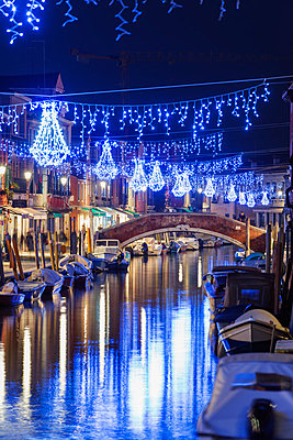 Christmas decorations reflected in a canal, Murano, Venice, UNESCO World Heritage Site, Veneto, Italy, Europe - p871m1013085 by Christian Kober