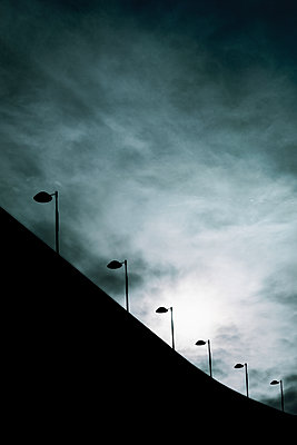 Silhouette of a high building with floodlights - p1228m2133336 by Benjamin Harte