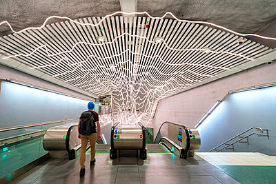 Man at the escalators in Odenplan metro station, Stockholm, Sweden (MR) - p651m2152385 by Roberto Moiola