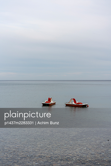 Two pedal boats anchoring offshore - p1437m2283331 by Achim Bunz