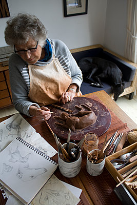 Sculpting in clay - p1121m1072263 by Gail Symes