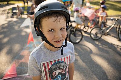 Portrait smiling boy wearing bike helmet - p1192m2017127 by Hero Images