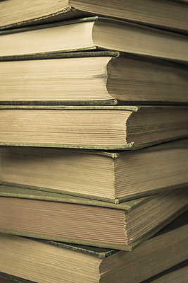 A stack of old hard cover books, with worn edges and aged yellowing paper.  - p1100m876806f by Paul Edmondson