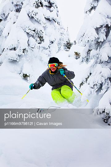 Woman Skiing Through Trees
