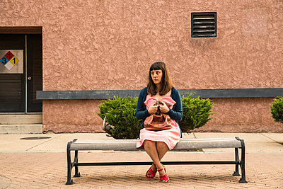 Woman sitting on bench - p1291m1586698 by Marcus Bastel