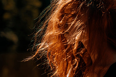 Wind blowing red hair of Caucasian woman - p555m1531637 by Ivan Ozerov