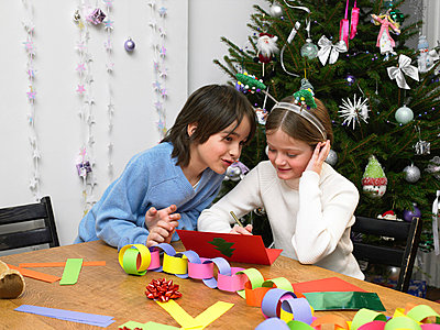 Children making christmas cards and decorations - p9249823f by Image Source