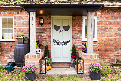 Door Of House Decorated For Halloween Trick Or Treating - p1407m1530297 by Guerrilla