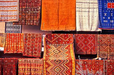 Berber Carpets Hanging In Souk In La Criee Berbere - p644m727933 by Paul Quayle